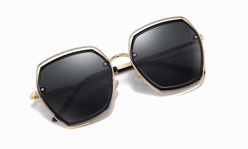 black square sunglasses with gold trim, gold nose bridge