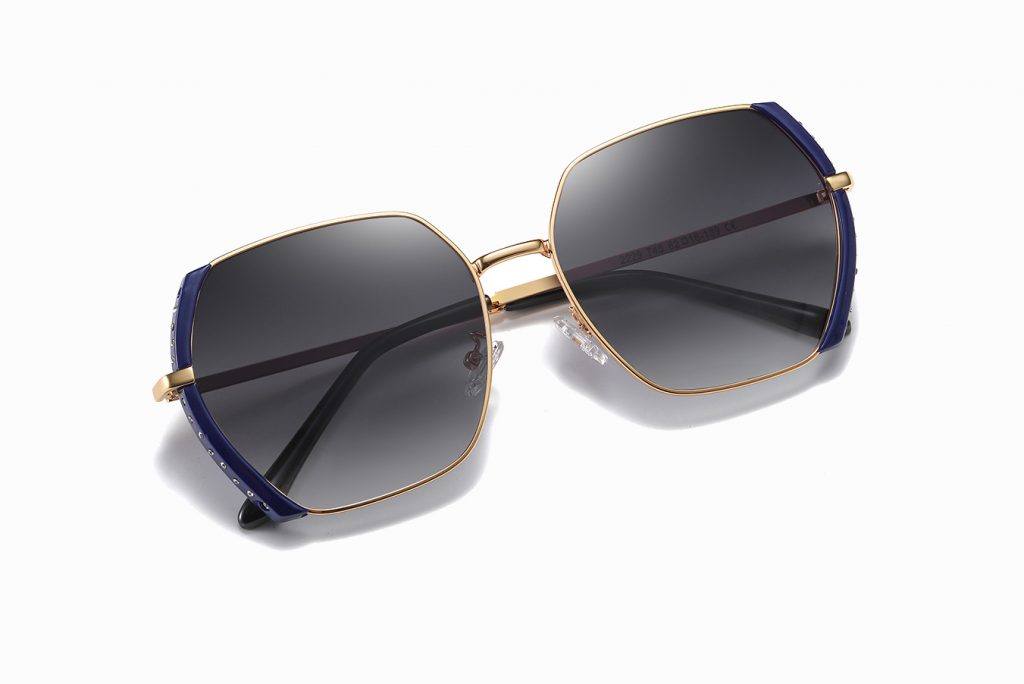 gray gradient sunglasses with gold frame and deep blue side trim