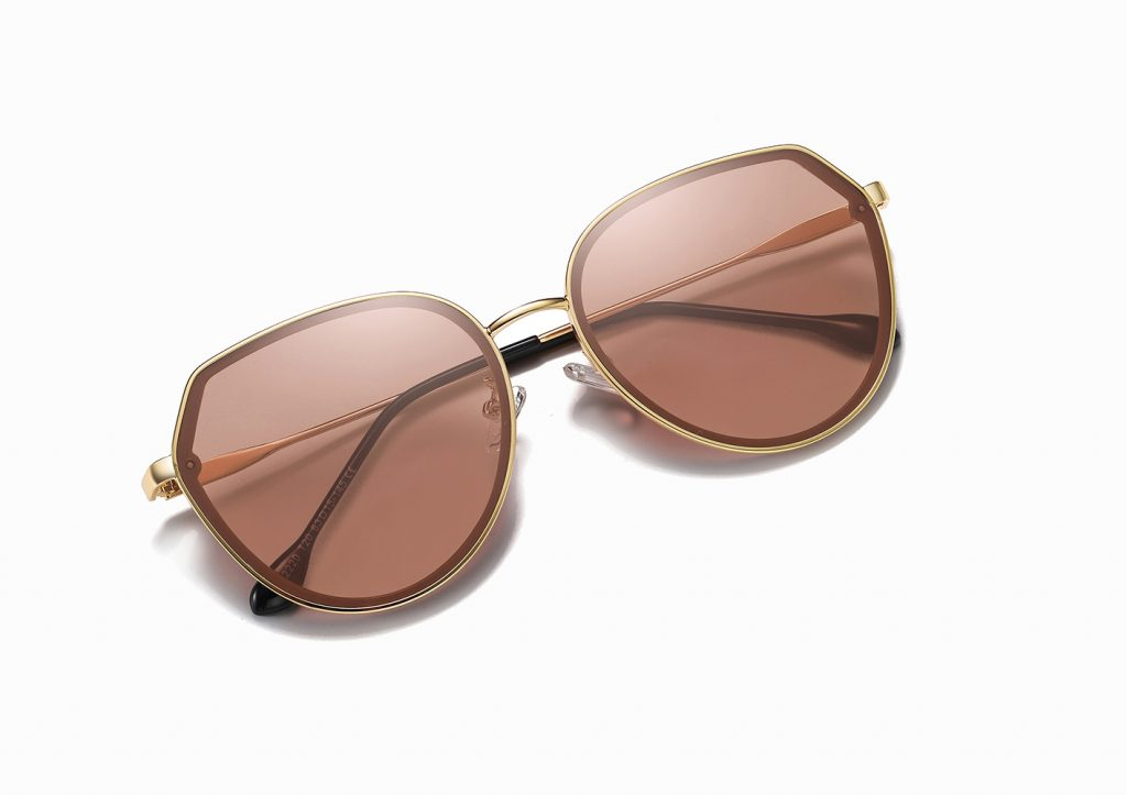 light brown round sunglasses with gold trim, brown tinted lenses with thin temple arms