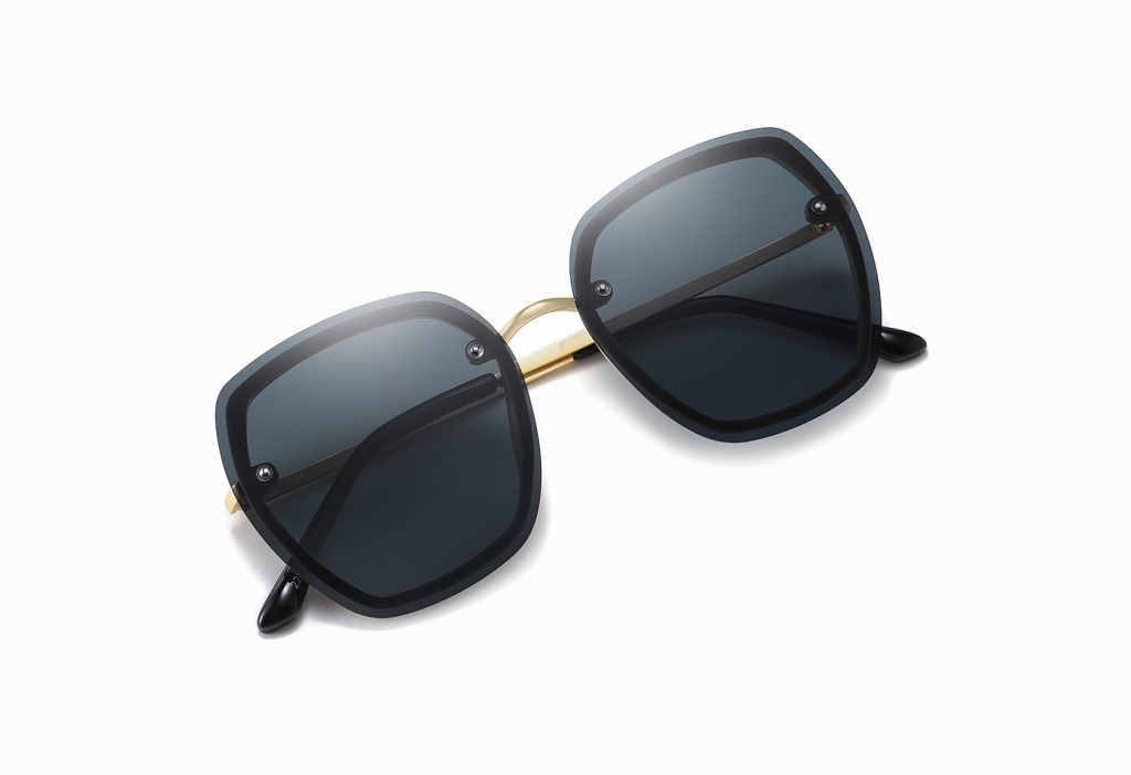 deep gray sunglasses with gold nose bridge