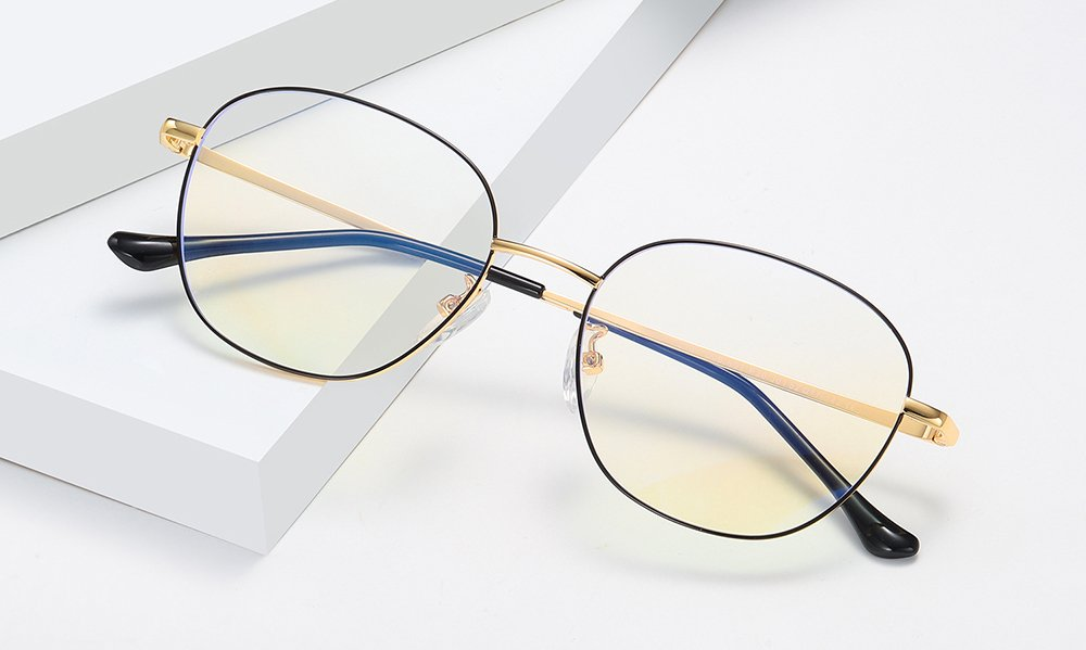 square wire frame eyeglasses and gold nose bridge