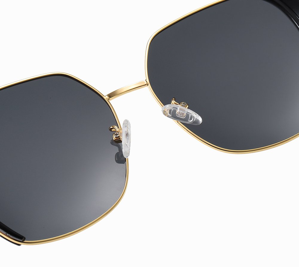 adjustable nose pads, gold nose bridge, black lens of this shade