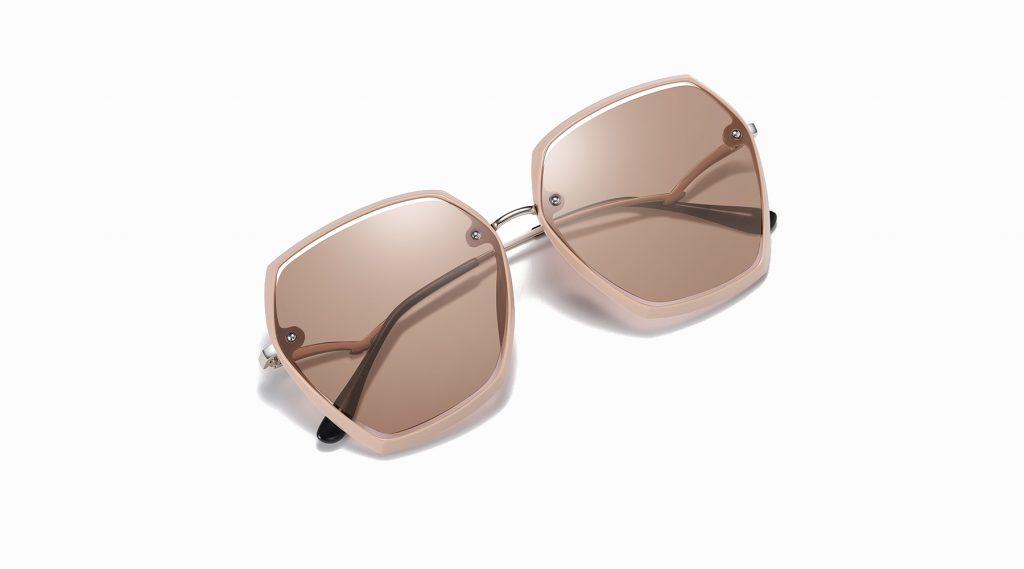 light brown sunglasses, geometrc frame shape and silver nose bridge
