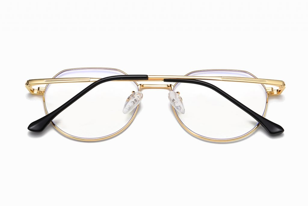 round eyeglasses with gold temple arms black ending tips