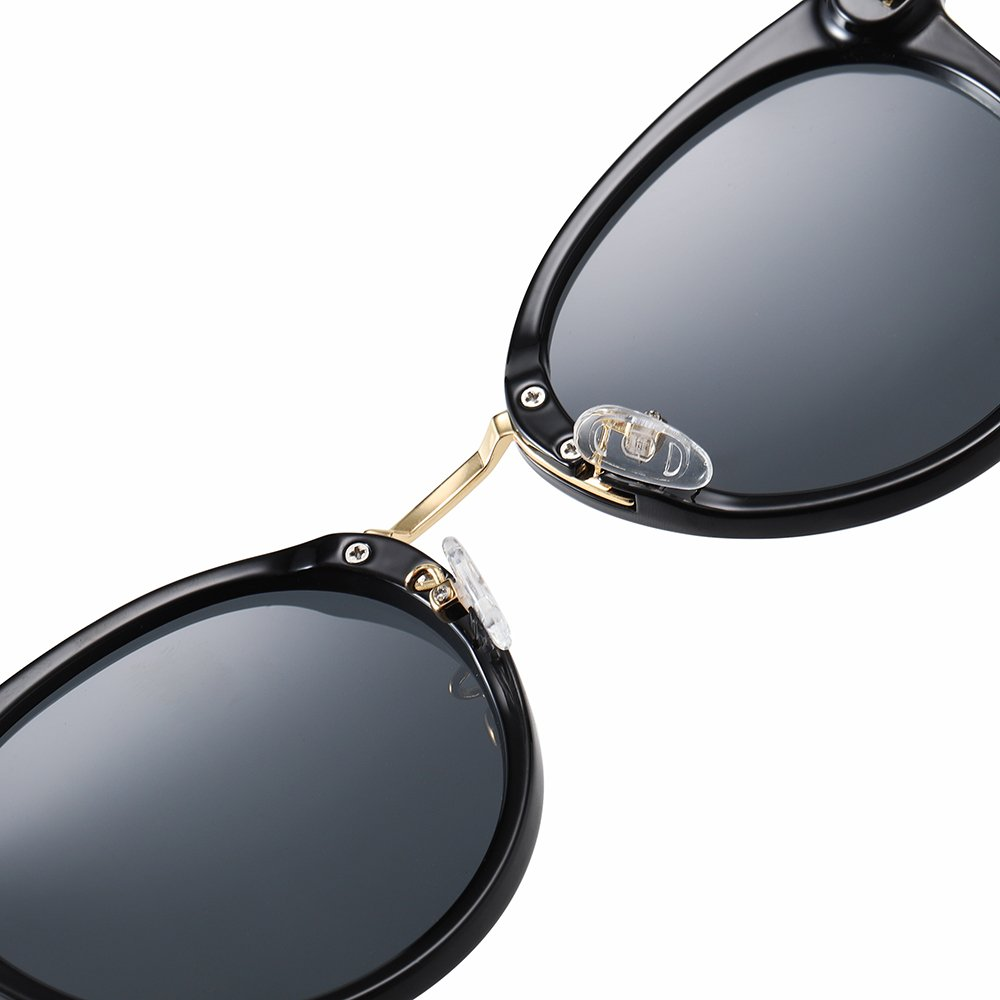 black sunglasses with adjustable nose pad and gold nose bridge