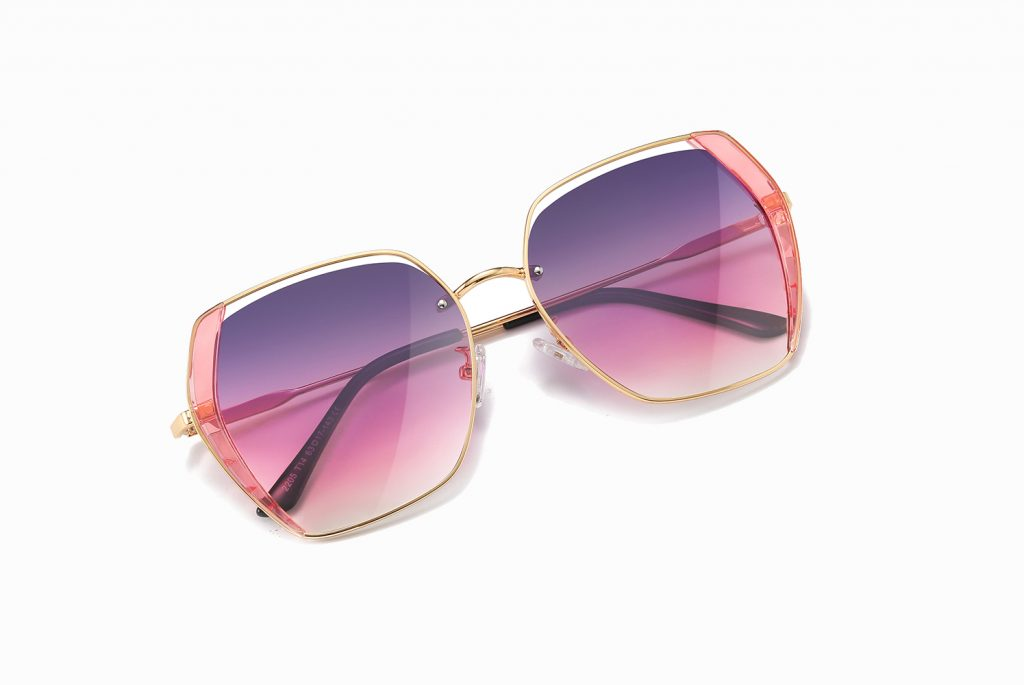 purple pink gradient sunglasses trimmed with gold, gold nose bridge
